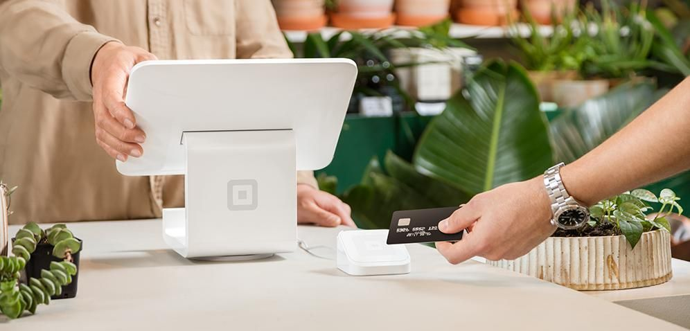 Square's contactless chip reader connects wirelessly with apps on tablets or POS systems