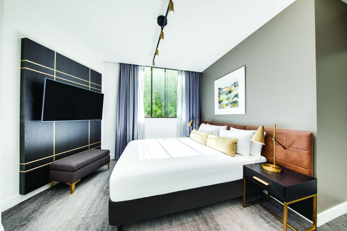 A newly refurbished deluxe suite at Vibe Hotel Sydney.