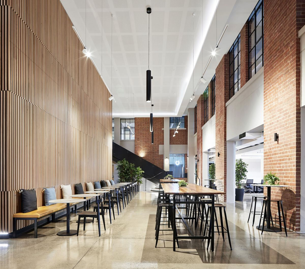 Coworking operator United Co's premises by PTID is an adaptive reuse of an old warehouse. Photo: Tatjana Plitt