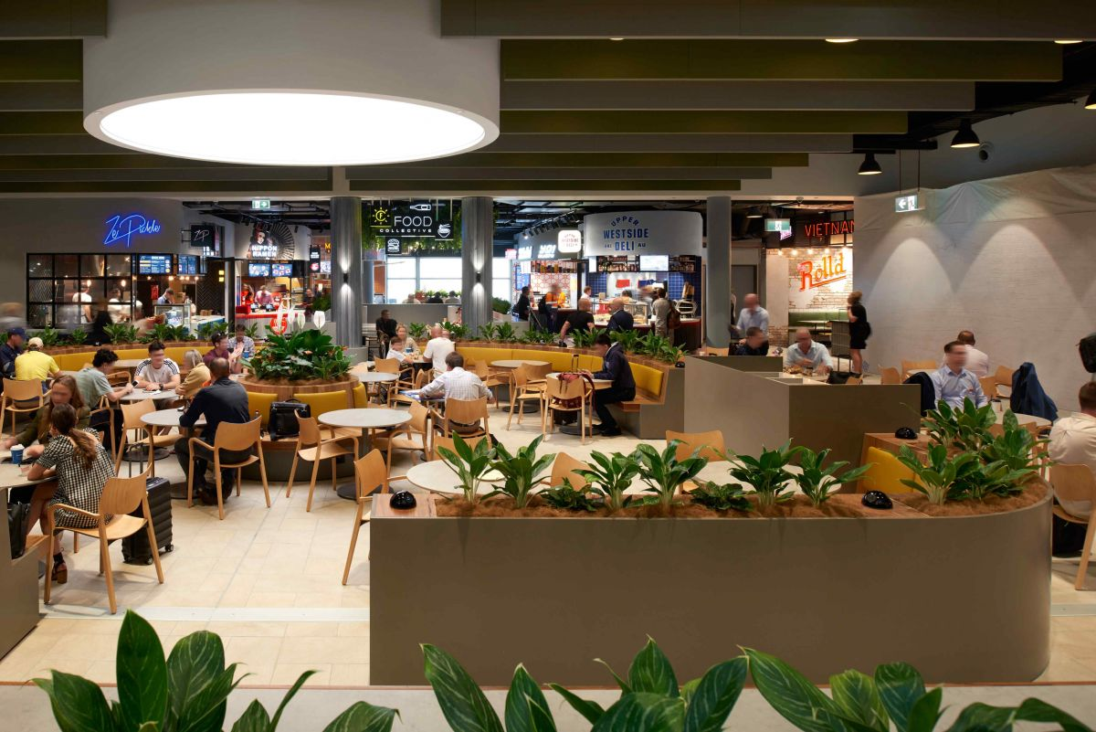 The seating area creates a welcoming environment for travellers seeking to grab a quick bite or to relax.