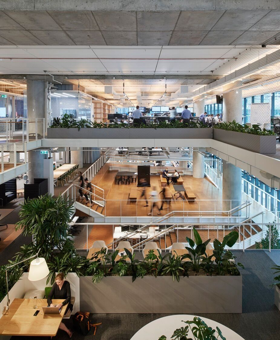 Image: Activity based workspaces that allow users to work in different areas according to their needs and preferences are accessed through staircases that promote connectivity and wellbeing through movement. (Image: Hassell)