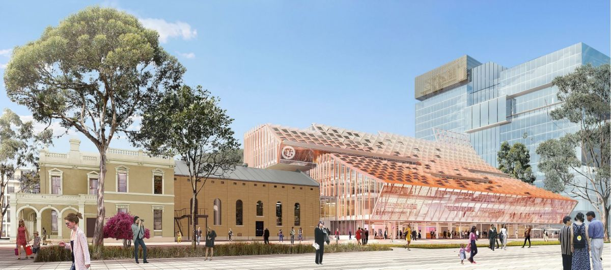 The new building integrates with Parramatta's existing Town Hall by 'protectively' framing the existing building with the cantilevered Council Chambers.